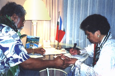 His Royal Majesty, Akahi Nui signs treaty with President Madame C. Bernard Tamaela, the Republic of Maluku